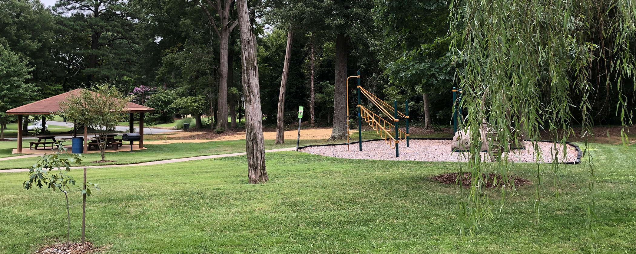 The park surrounding the Civic Center features a sand volleyball court, playground, green space, and a picnic shelter.